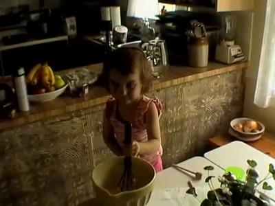 Maeve baking, Mom in kitchen