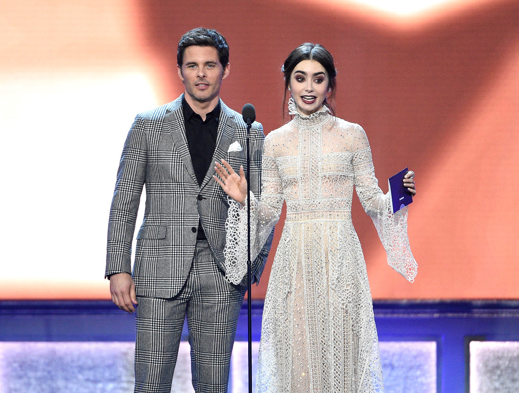 . James Marsden, left, and Lily Collins present the award for best animated feature at the 22nd annual Critics\' Choice Awards at the Barker Hangar on Sunday, Dec. 11, 2016, in Santa Monica, Calif. (Photo by Chris Pizzello/Invision/AP)