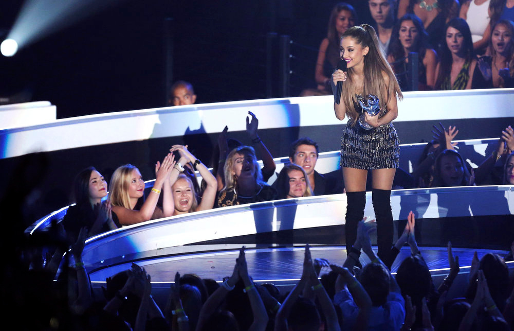 . Ariana Grande accepts the award for Best Pop Video at the MTV Video Music Awards at The Forum on Sunday, Aug. 24, 2014, in Inglewood, Calif. (Photo by Matt Sayles/Invision/AP)