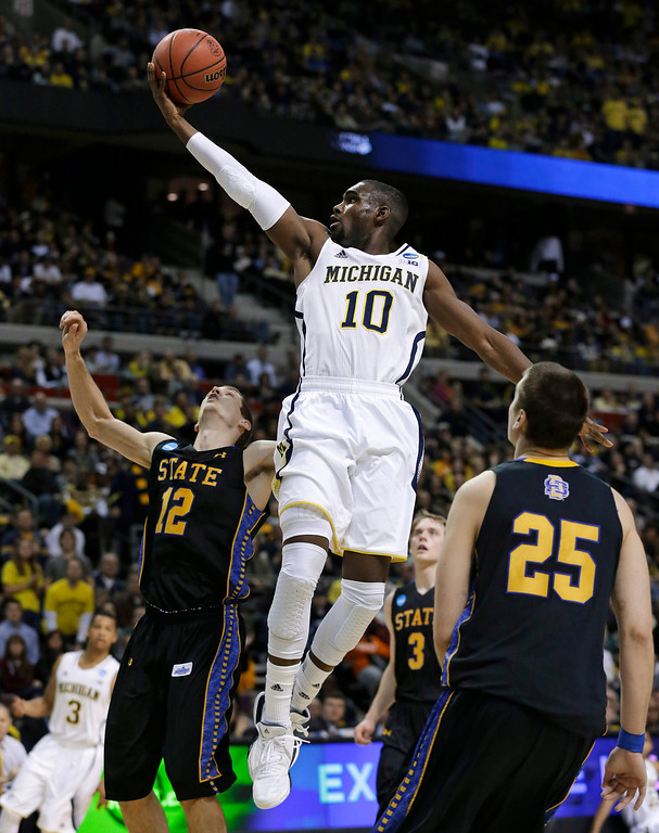 . Michigan guard Tim Hardaway Jr. (10) drives against South Dakota State guard Brayden Carlson (12) in the second half of a second-round game of the NCAA men\'s college basketball tournament in Auburn Hills, Mich., Thursday, March 21, 2013. Michigan won 71-56. (AP Photo/Paul Sancya)