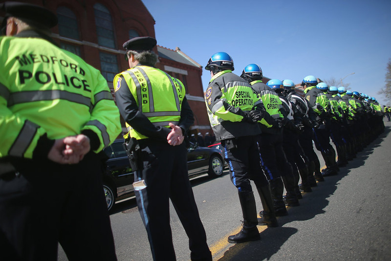 . The funeral procession passes through town for 29-year-old Krystle Campbell, who was one of three people killed in the Boston Marathon bombings, on April 22, 2013 in Medford, Massachusetts. The 29-year-old restaurant manager, raised in Medford, Massachusetts, was killed in the blasts at the finish line of the Boston Marathon. Massachusetts Gov. Deval Patrick has asked residents to observe a moment of silence at the time of the first explosion at 2:50 p.m. this afternoon.  (Photo by Mario Tama/Getty Images)