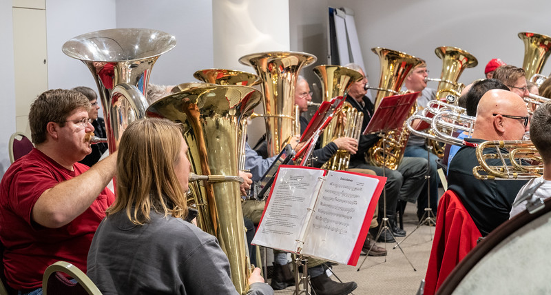 One silver tuba among eight gold ones