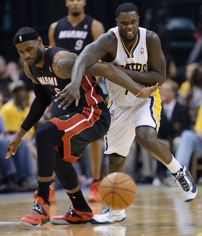 . Indiana Pacers guard Lance Stephenson (1) and Miami Heat forward LeBron James (6) scramble for a loose ball during the second half of Game 5 of the NBA basketball Eastern Conference finals in Indianapolis, Wednesday, May 28, 2014. (AP Photo/Michael Conroy)