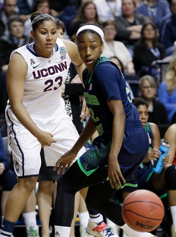 . Connecticut forward Kaleena Mosqueda-Lewis (23) and Notre Dame guard Jewell Loyd (32) vie for a passed ball during the first half of the championship game in the Final Four of the NCAA women\'s college basketball tournament, Tuesday, April 8, 2014, in Nashville, Tenn. (AP Photo/Mark Humphrey)