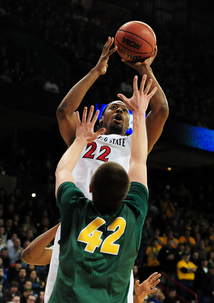 . Josh Davis #22 of the San Diego State Aztecs shoots over Marshall Bjorklund #42 of the North Dakota State Bison in the second half during the Third Round of the 2014 NCAA Basketball Tournament at Spokane Veterans Memorial Arena on March 22, 2014 in Spokane, Washington.  (Photo by Steve Dykes/Getty Images)