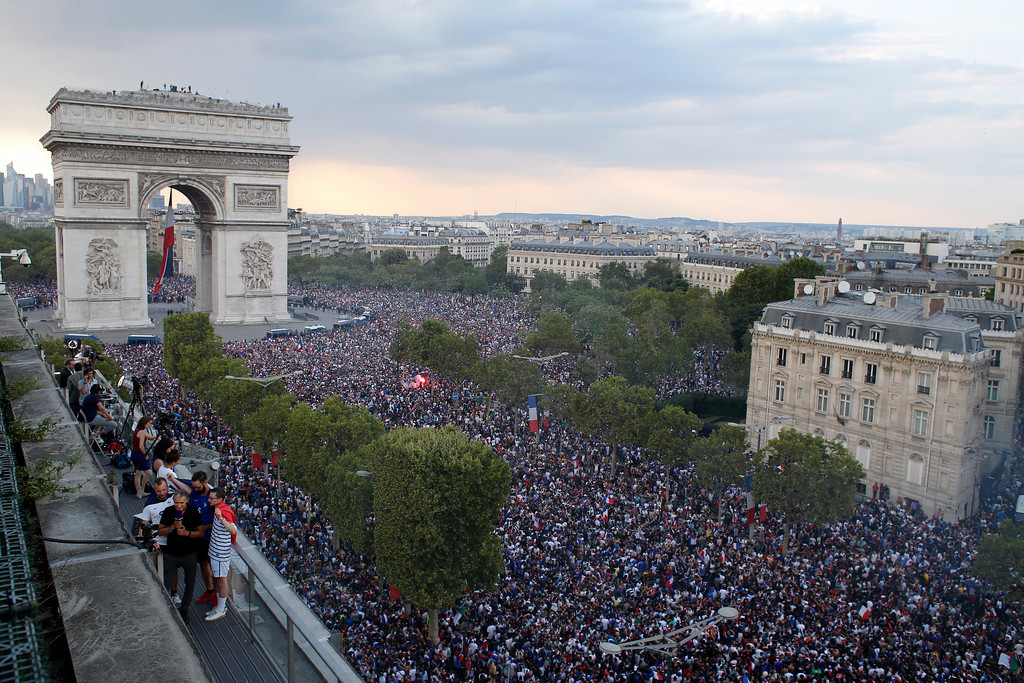 . In this picture taken from the terrace of the Publicis Group people take the streets around the Arc de Triomphe to celebrate France\'s World Cup victory over Croatia, in Paris, France, Sunday, July 15, 2018. France won the final 4-2. (AP Photo/Thibault Camus)