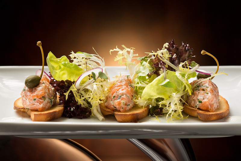 Smoked salmon tartar with chives, caper-lemon yogurt and mini toasted baguette is displayed in the Aux Beaux Arts restaurant at MGM Macau.