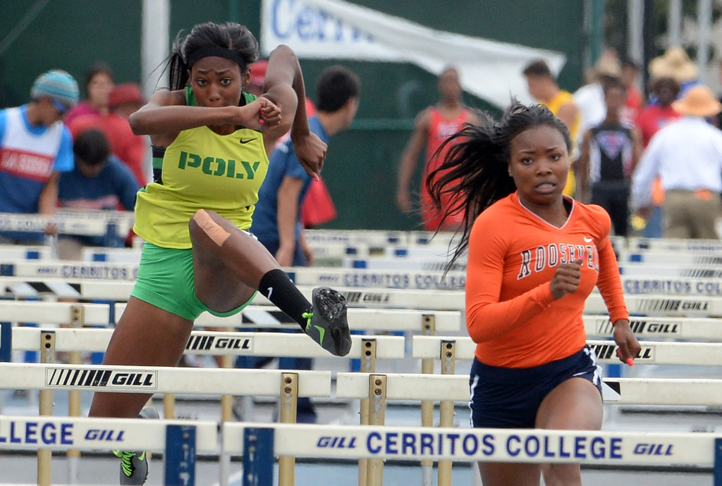 . Long Beach Poly\'s Ebony Crear, left, with Roosevelt\'s Jasmyne Graham compete in the division 1 100 meter high hurdles during the CIF Southern Section track and final Championships at Cerritos College in Norwalk, Calif., Saturday, May 24, 2014.   (Keith Birmingham/Pasadena Star-News)