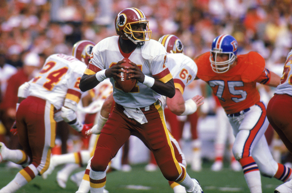 . Quarterback Doug Williams #17 of the Washington Redskins looks to pass during Super Bowl XXII against the Denver Broncos at Jack Murphy Stadium on January 31, 1988 in San Diego, California.  The Redskins won 42-10.  (Photo by Rick Stewart/Getty Images)