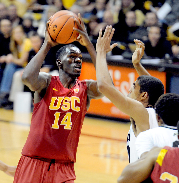 . DeWayne Dedmon of Southern California shoots over Josh Scott of Colorado during the first half of the January 10, 2013 game in Boulder.   Cliff Grassmick/Daily Camera