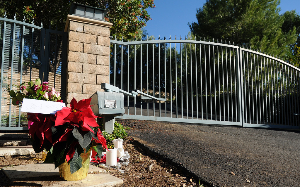 . Fans of singer Jenni Rivera left flowers and candles outside of her Encino, CA home on December 10, 2012.  (Dean Musgrove/Los Angeles Daily News)