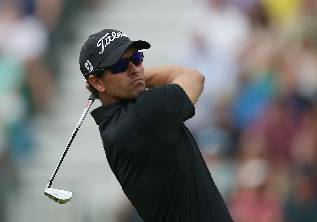 . Adam Scott of Australia plays a shot off the 4th tee during the final round of the British Open Golf championship at the Royal Liverpool golf club, Hoylake, England, Sunday July 20, 2014. (AP Photo/Jon Super)