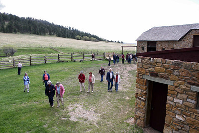Trekking from the Anderson barn to the springhouse.  The old bunkhouse is at right.  It is used for equipment and storage.