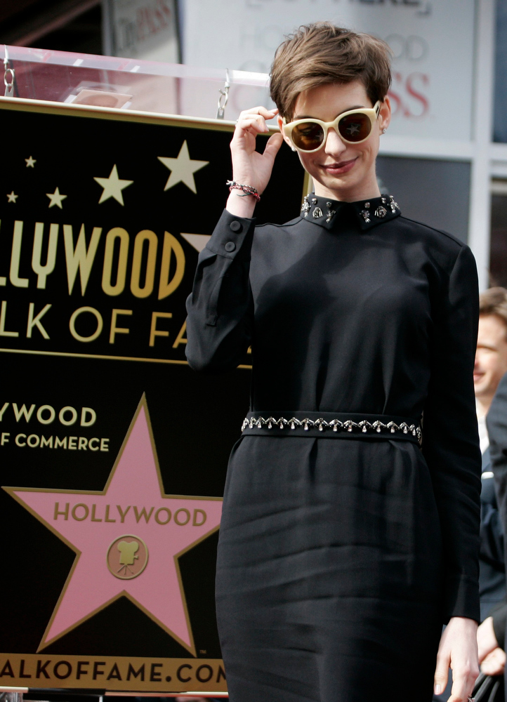 Description of . Actress Anne Hathaway arrives at ceremonies honoring actor Hugh Jackman with a star on the Hollywood Walk of Fame in Hollywood, California, December 13, 2012. REUTERS/Jonathan Alcorn