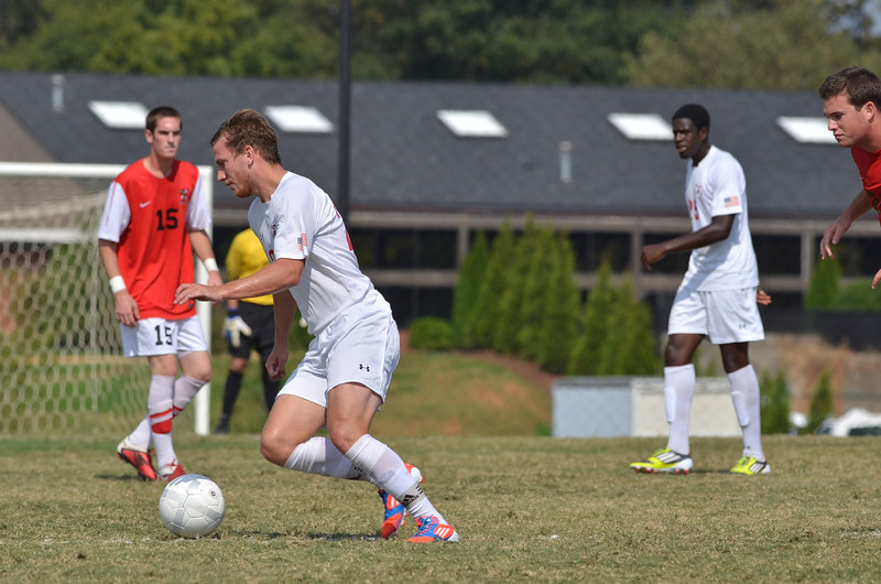 John Sargent (20) works hard to dribble the ball down the field.
