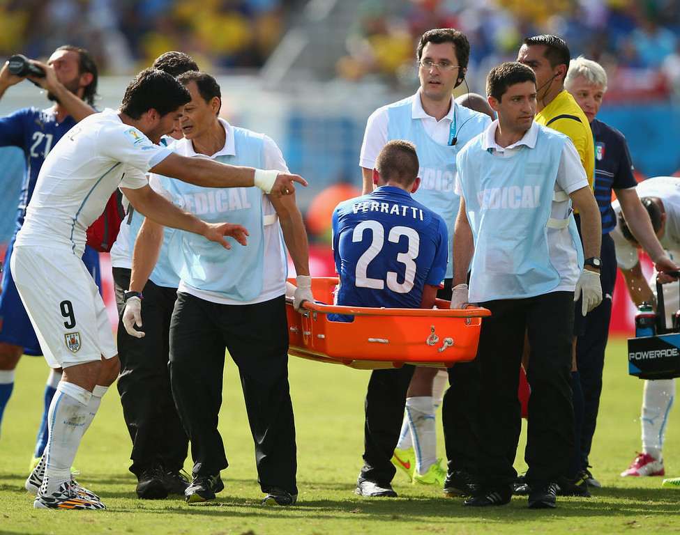 . Luis Suarez of Uruguay (L) reacts as Marco Verratti of Italy is stretchered off the pitch during the 2014 FIFA World Cup Brazil Group D match between Italy and Uruguay at Estadio das Dunas on June 24, 2014 in Natal, Brazil.  (Photo by Clive Rose/Getty Images)