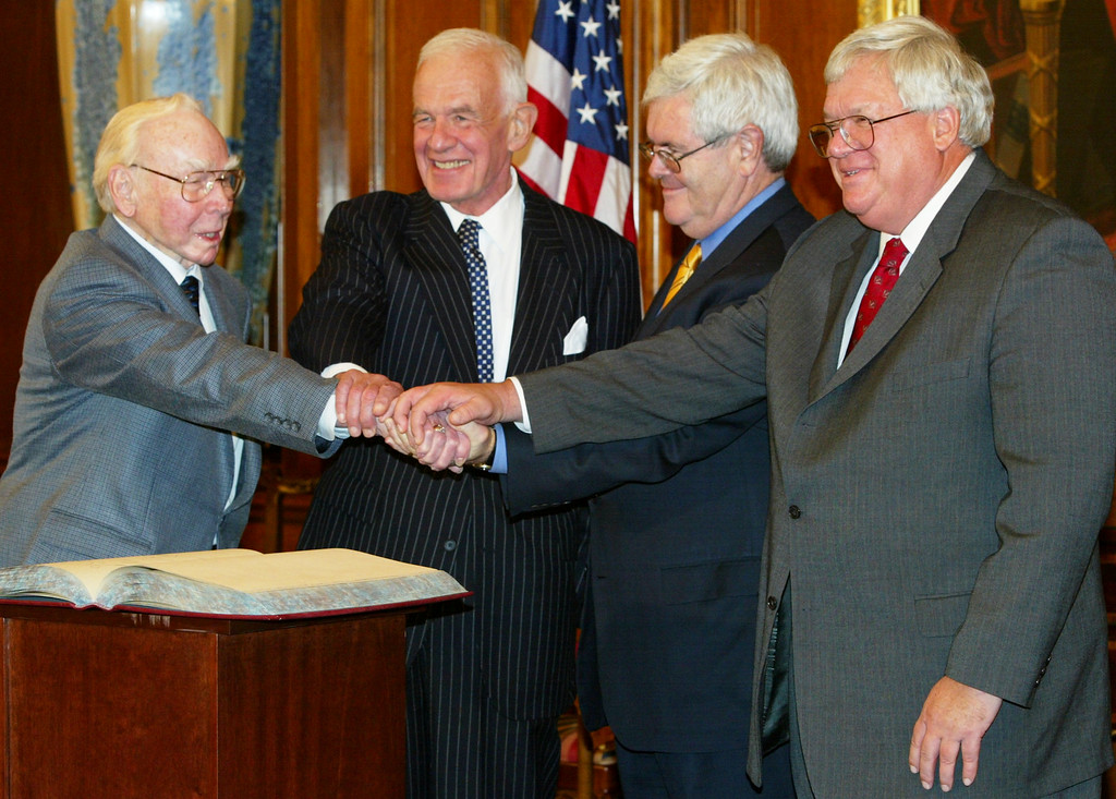 . Speaker of the House Dennis Hastert (R) (R-IL) joins former speakers of the House (L-R) James Wright Jr. (D-TX), Thomas Foley (D-WA) and Newt Gingrich (R-GA) in a four-way handshake during a meeting on Capitol Hill November 12, 2003 in Washington, DC. The speakers were on Capitol Hill to participate an event on the changing nature of the U.S. House of Representatives speakership.  (Photo by Alex Wong/Getty Images)