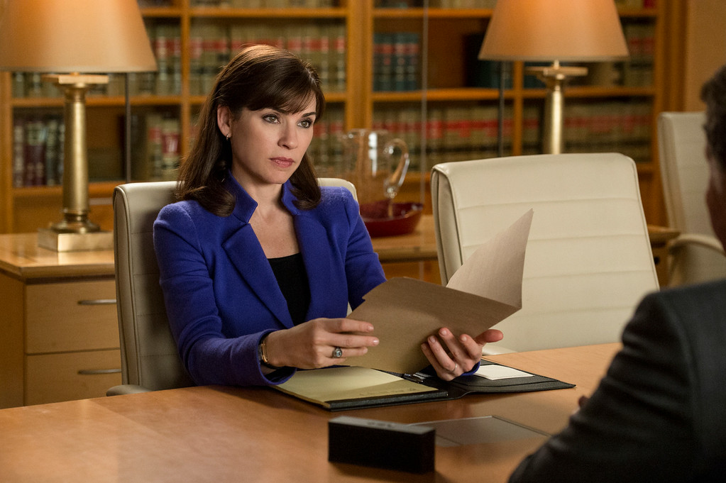""". This image released by CBS shows Julianna Margulies as Alicia Florrick in a scene from \""""The Good Wife.\"""" Margulies was nominated for an Emmy Award for best actress in a drama series on, Thursday July 10, 2014. The 66th Primetime Emmy Awards will be presented Aug. 25 at the Nokia Theatre in Los Angeles. (AP Photo/CBS, David Giesbrecht)"""