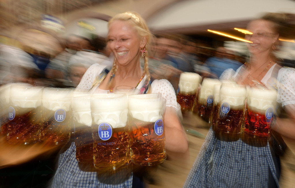 . Waitresses serve beer during the opening of the Oktoberfest beer festival at the Theresienwiese in Munich, southern Germany, on September 21, 2013. The world\'s biggest beer festival Oktoberfest will run until October 6, 2013.  AFP PHOTO / CHRISTOF STACHE/AFP/Getty Images