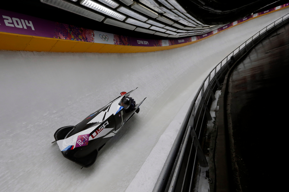 . The team from the United States USA-1, piloted by Elana Meyers with brakeman Lauryn Williams, speed down the track during the women\'s two-man bobsled competition at the 2014 Winter Olympics, Tuesday, Feb. 18, 2014, in Krasnaya Polyana, Russia. (AP Photo/Natacha Pisarenko)