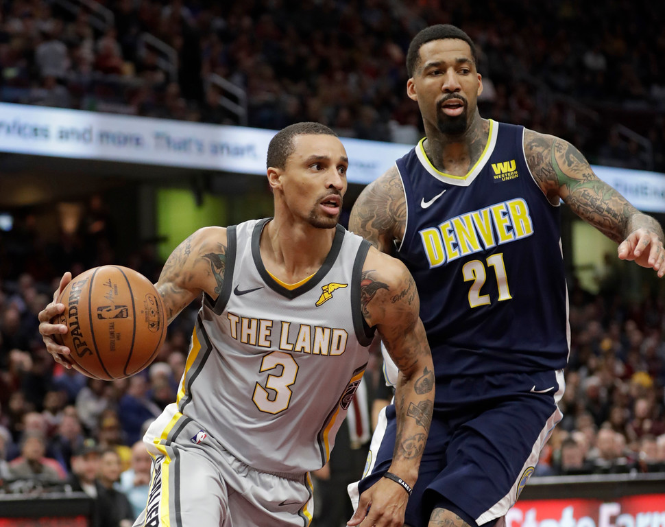. Cleveland Cavaliers\' George Hill (3) drives past Denver Nuggets\' Wilson Chandler (21) in the first half of an NBA basketball game, Saturday, March 3, 2018, in Cleveland. (AP Photo/Tony Dejak)