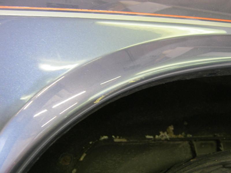 Scrape in paint on left rear arch lip