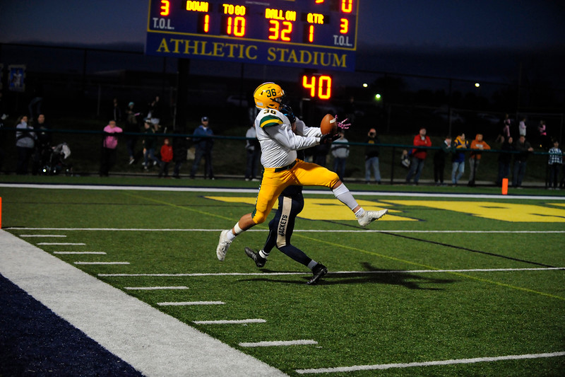Deer Lakes #36 Jack Hollibaugh catches a long throw during a game at Freeport Stadium on Friday October 4, 2019 (Jason Swanson photo)