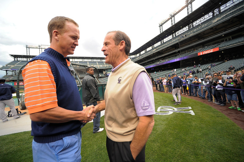 . Denver Broncos Peyton Manning shakes hands with ,Dick Monfort duirng the Colorado Rockies New York Yankees batting practice  May 7, 2013 at Coors Field. (Photo By John Leyba/The Denver Post)