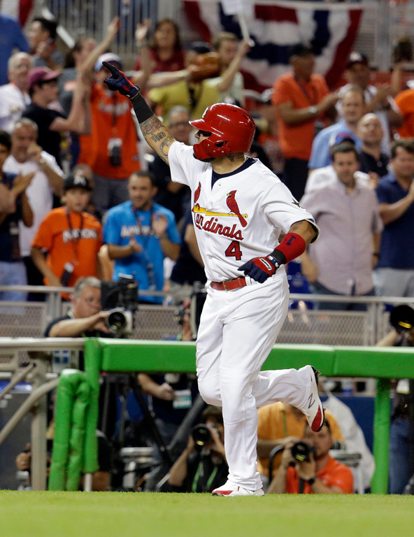 . National League\'s St. Louis Cardinals catcher Yadier Molina (4), rounds the bases after hitting a homerun in the sixth inning, during the MLB baseball All-Star Game, Tuesday, July 11, 2017, in Miami. (AP Photo/Lynne Sladky)