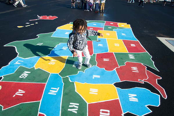 09/03/19 Wesley Bunnell | StaffrrOneil Teape , age 6, runs across a map of the U.S. while playing at Smalley School on Tuesday September 3, 2019. Oneil's is from Ethiopia and starting his first day of school in the United States. .