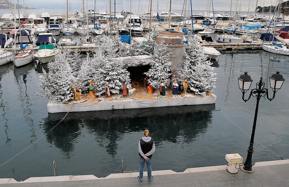 Description of . A floating Nativity crib is displayed in the harbor of Saint Jean Cap Ferrat, south eastern France on Friday, Dec. 21, 2012.(AP Photo/Lionel Cironneau)
