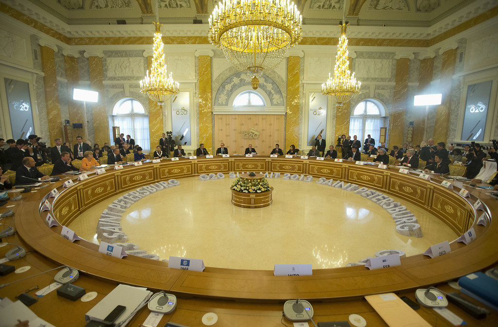 . Russian President Vladimir Putin speaks as he gives opening remarks at the start of the G-20 Working Session at the Konstantin Palace, Thursday, Sept. 5, 2013 in St. Petersburg, Russia. (AP Photo/Pablo Martinez Monsivais/Pool)