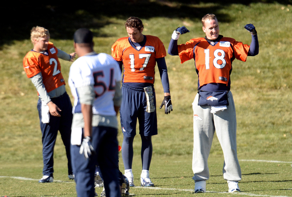 . Denver Broncos Peyton Manning (18), Brock Osweiler (17), Zac Dysert (2) and Practice Squad Brandon Marshall (54) are warming up for the team practice at Dove Valley practice field, Englewood, Colorado, November 15, 2013. (Photo by Hyoung Chang/The Denver Post)