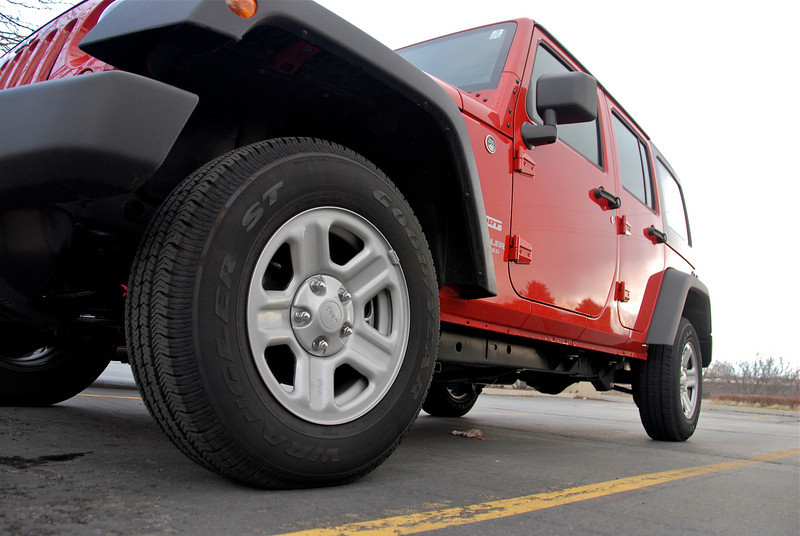 2011/3/22 – John David at work bought this cool new red Jeep. I give JD grief constantly that the Jeep is cool, but he really needs to get some man tires and dump the sissy girl tires it came with. I think he is getting tired of all the harassment.