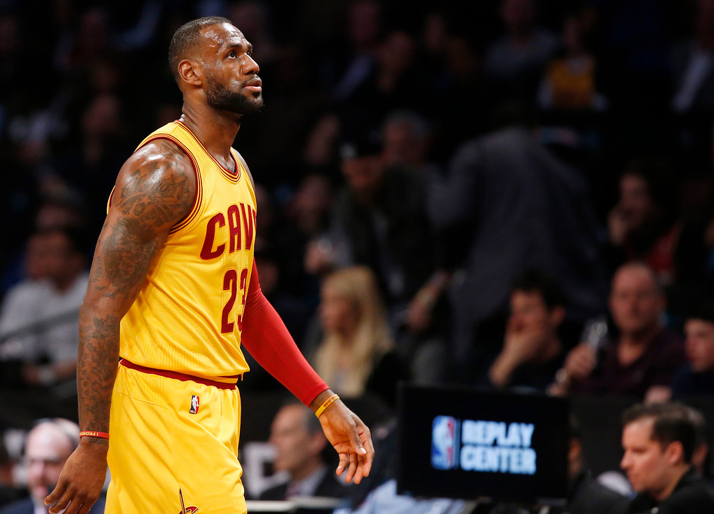 . LeBron James walks down the sideline in the first half of an NBA basketball game against the Brooklyn Nets, Thursday, March 24, 2016, in New York. (AP Photo/Kathy Willens)