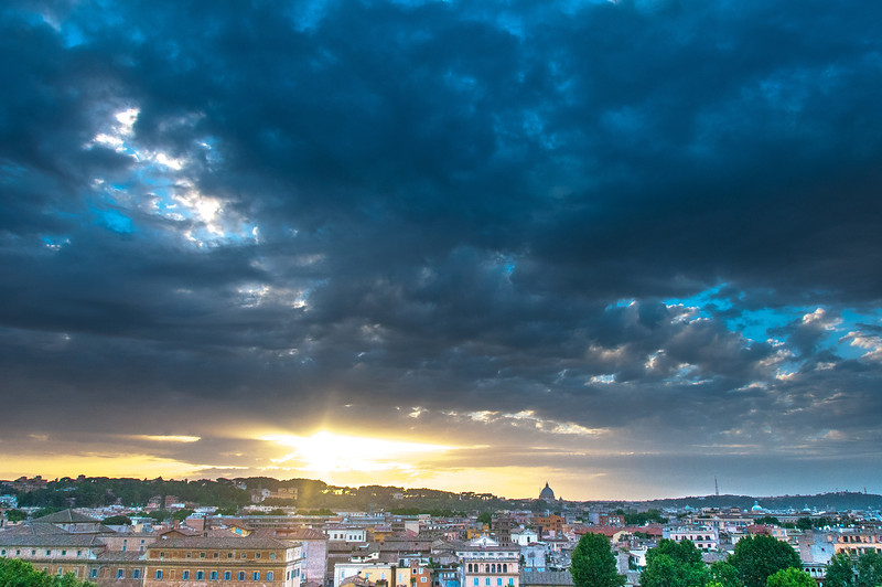 Heavy clouds above the Rome skyline in Italy