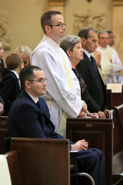 Richard Jasper sits with his family during the Ordination of  at Cathedral of Saint Peter Church, Saturday, May 20, 2017. wwwDonBlakePhotography.com