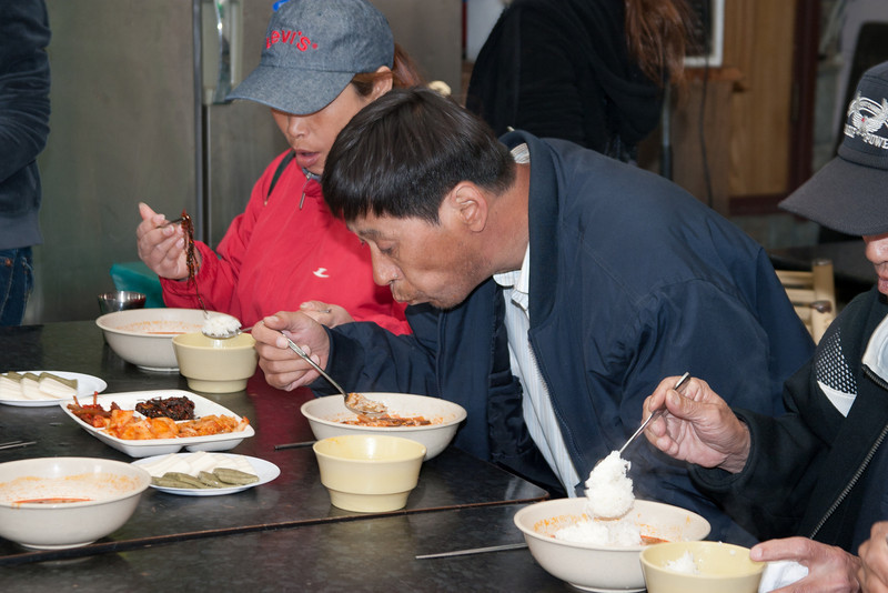 Homeless man enjoying his rice and hot spicy soup