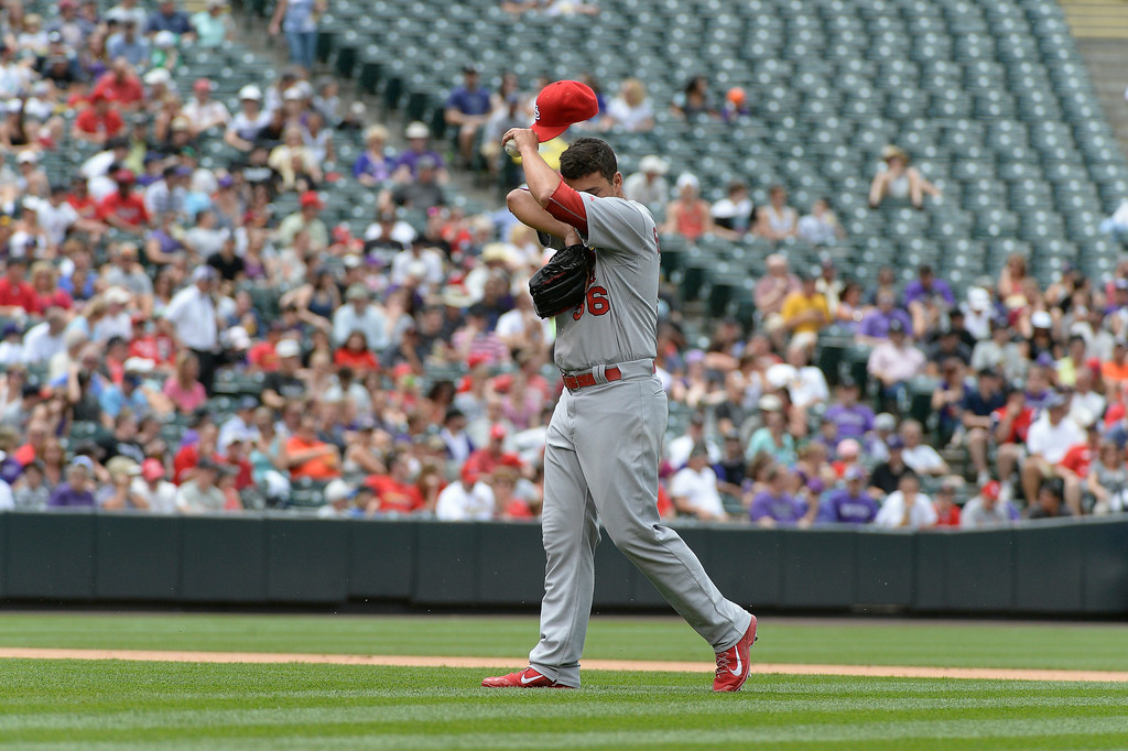 . St. Louis Cardinals starting pitcher Marco Gonzales (56) wipes his fore head during the fourth inning against the Colorado Rockies June 25, 2014 at Coors Field. (Photo by John Leyba/The Denver Post)