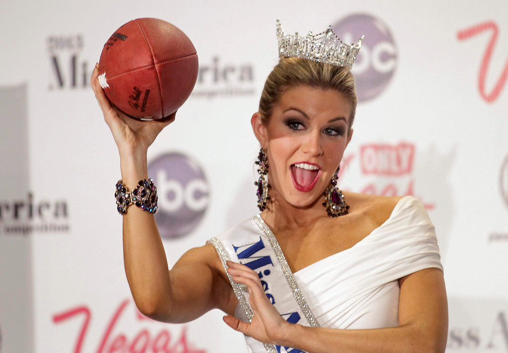 . Miss America 2013 Mallory Hytes Hagan, 23, Miss New York, poses with a football during a news conference after winning the Miss America Pageant in Las Vegas January 12, 2013. REUTERS/Steve Marcus