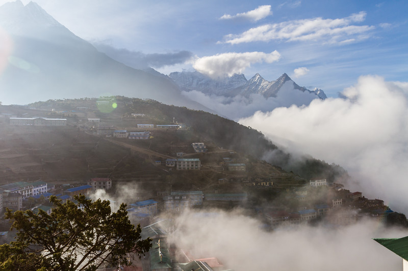 Sunrise view of village with snowcapped mountain in background - Nepal
