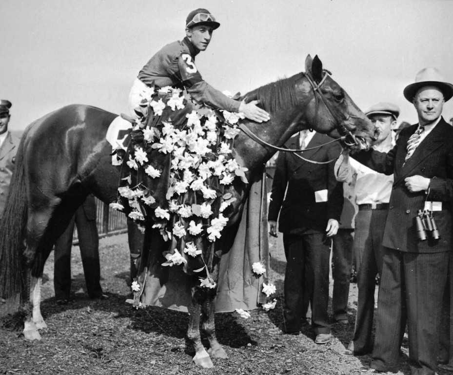 . 1941:  WHIRLAWAY - Whirlaway is draped with the floral tribute in the winner\'s circle at Belmont Park, N.Y., on June 7, 1941 after winning the Belmont Stakes race of the Triple Crown with jockey Eddie Arcaro.   (AP Photo)