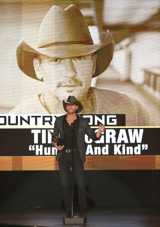 ". Tim McGraw accepts the award for favorite country song for ""Humble and Kind\"" at the American Music Awards at the Microsoft Theater on Sunday, Nov. 20, 2016, in Los Angeles. (Photo by Matt Sayles/Invision/AP)"