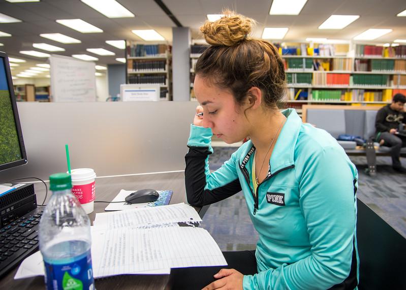 Celestina Encinia studies for her human resources class.