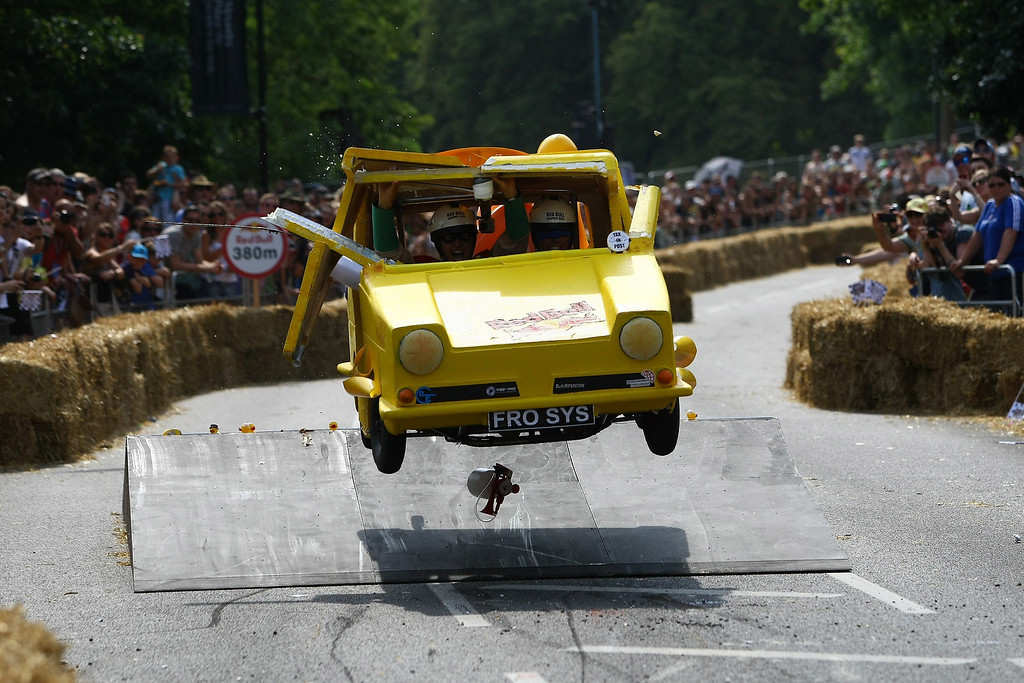 . A team goes over a jump during the Red Bull Soapbox Race at Alexandra Palace on July 14, 2013 in London, England. The Red Bull Soapbox Race returned to London after nine years and encourages competitors to build and race their own homemade soapboxes down a hill.  (Photo by Jordan Mansfield/Getty Images)