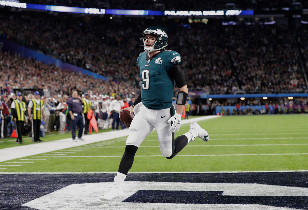 . Philadelphia Eagles quarterback Nick Foles (9) celebrates a touchdown, during the first half of the NFL Super Bowl 52 football game against the New England Patriots Sunday, Feb. 4, 2018, in Minneapolis. (AP Photo/Tony Gutierrez)