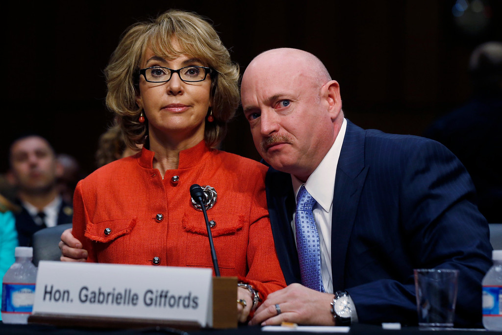 . Former U.S. Rep. Gabrielle Giffords (L) delivers her opening remarks while seated next to her husband, former U.S. Navy Captain Mark Kelly, during a hearing held by the Senate Judiciary committee about guns and violence on Capitol Hill in Washington, January 30, 2013.  REUTERS/Larry Downing