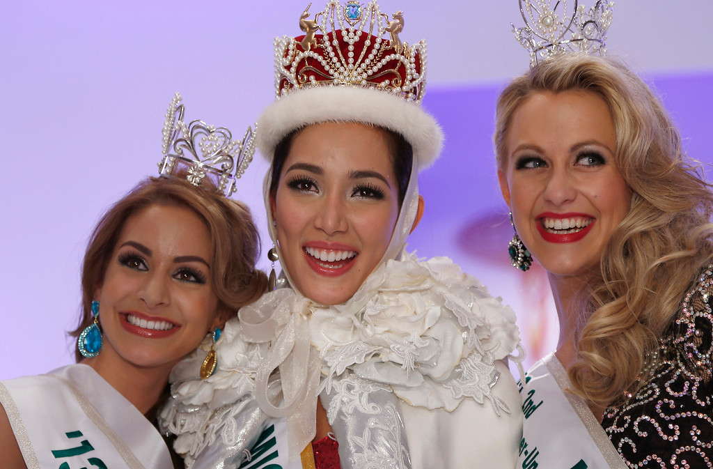 . Newly-crowned Miss International Bea Rose Santiago, center, of the Philippines smiles with 1st runner-up Miss New Zealand Casey Radley, left, and 2nd runner-up Miss Netherlands Nathalie den Dekker during the final of the 53rd Miss International Beauty Pageant in Tokyo Tuesday, Dec. 17, 2013. (AP Photo/Shizuo Kambayashi)