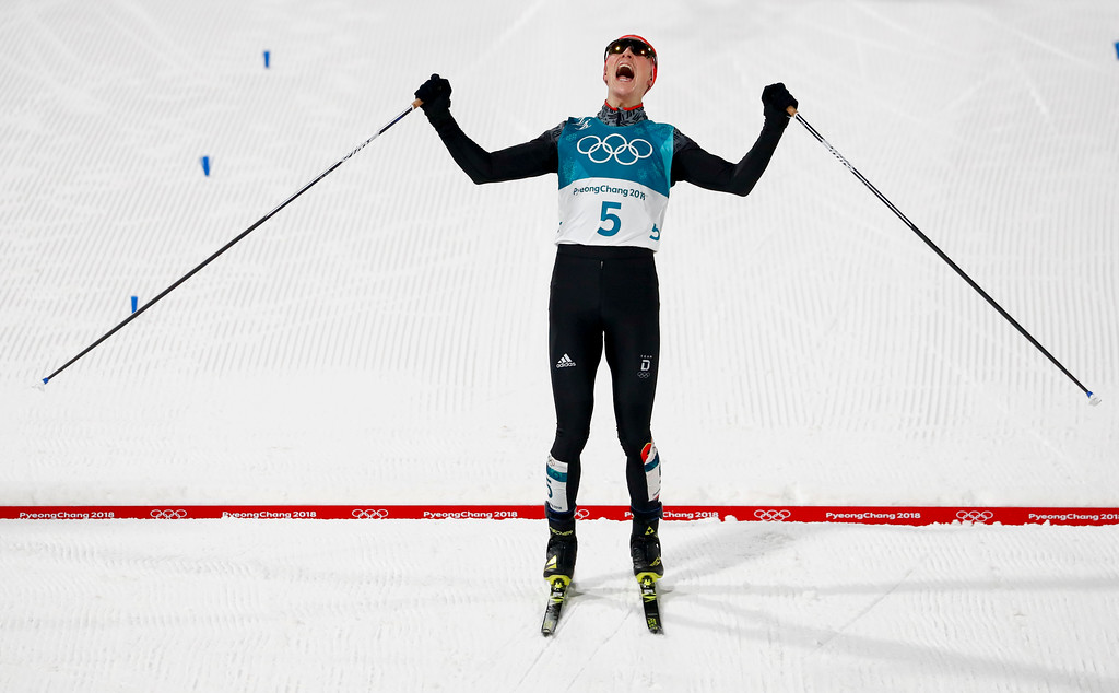 . Eric Frenzel, of Germany, celebrates after winning the the gold medal after the 10km cross-country skiing portion of the nordic combined event at the 2018 Winter Olympics in Pyeongchang, South Korea, Wednesday, Feb. 14, 2018. (AP Photo/Matthias Schrader)
