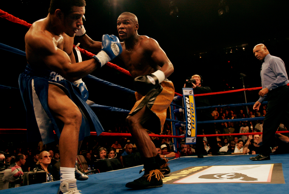. Floyd Mayweather Jr., right, gets Shambra Mitchell up against the ropes during the third round of a welterweight bout at the Rose Garden, Saturday, Nov. 19, 2005, in Portland, Ore. Mayweather ended the fight with a straight right hand that landed below Mitchell\'s rib cage. Referee Richard Steele counted to 10 with Mitchell sitting on the ropes. (AP Photo/Tim LaBarge)